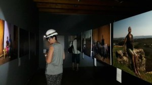 Visitors wear a miners hard hat and view the photographs with a torch